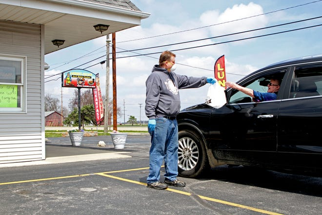 Mike Smith, general manager of Granny's Kitchen in Woodville, fills a curbside order. The opening of restaurants to indoor seating is still on hold in Ohio.