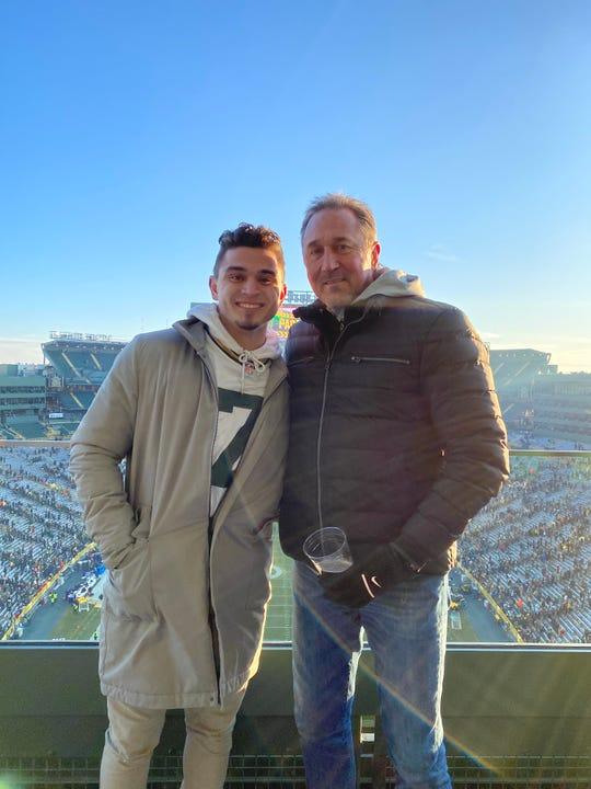 Bo Majkowski with his father, former Green Bay Packers quarterback Don Majkowski, at Lambeau Field.