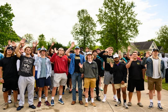 Loved ones of Greer football coach and athletic director Travis Perry show up to his front yard to show their support for his fight against stage four bile duct cancer Thursday, April 30, 2020.