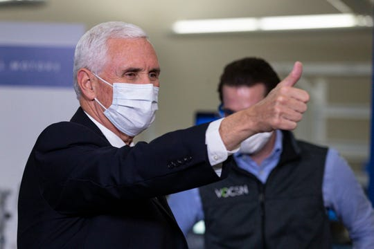 Vice President Mike Pence gestures while visiting the General Motors/Ventec ventilator production facility in Kokomo, Ind., Thursday, April 30, 2020. (AP Photo/Michael Conroy)
