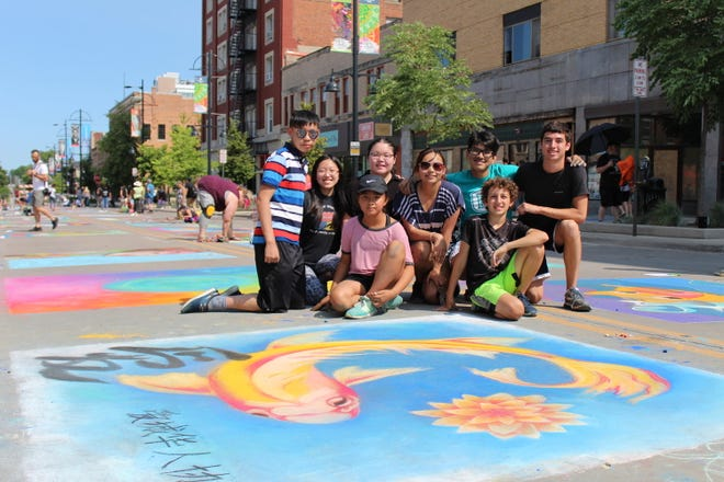 """This young talented team sponsored by the Iowa City Chinese Association won the Artist's Choice award last August during the """"Rock the Chalk"""" event downtown. Most are children of association members, and their art depicted the revamped organization's logo."""