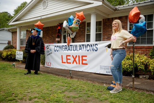 UTM Chancellor Keith Carver and graduating senior Lexie Bolin take a picture in front of a banner at Lexie's home in McKenzie