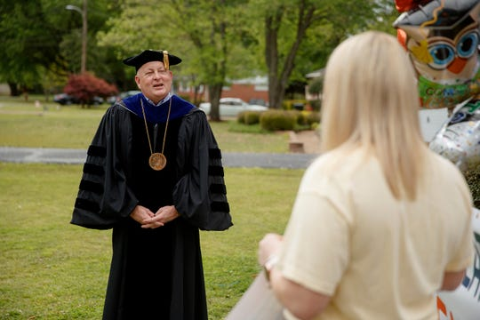 UTM Chancellor Keith Carver visited graduating senior Lexie Bolin at home in McKenzie to congratulate her for her accomplishment, wish her well and see how her mother, Stephanie, decorated their front yard in her honor.