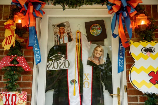 Lexie Bolin's mother, Stephanie, decorated their home's front door and front yard honoring her daughter for graduating from UT Martin.