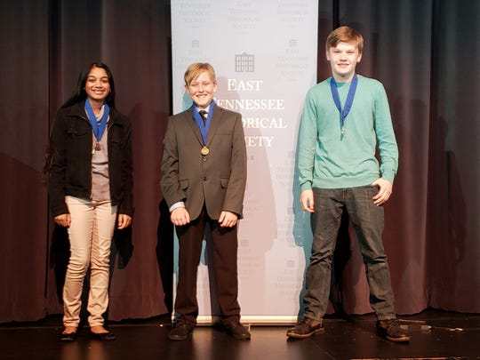 Lukas Bowen, right, finished second in the East Tennessee Historical Society's History Day competition in the junior individual paper category in February 2020. With him are third-place winner Maya Hira, left, of West Valley Middle School, and winner Alex Addlemon of Clayton-Bradley Academy. Bowen went on to finish first statewide.