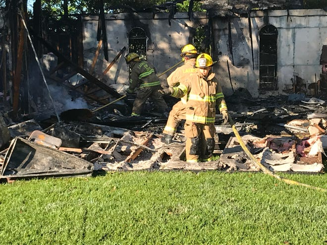 Lafayette firefighters work a blaze at a vacant synagogue.