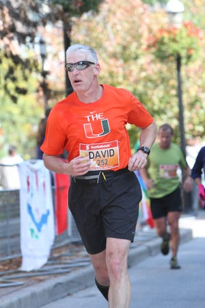 David Alexander runs in a marathon in Toronto. He plans on running 26.2 miles this Sunday to raise awareness and funds for the Lancaster Men's Chorus. The group's May concert has been cancelled, which will severely impact its scholarship fund.