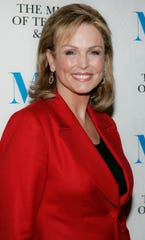 Phyllis George, one of the first female sports commentators, arrived at the