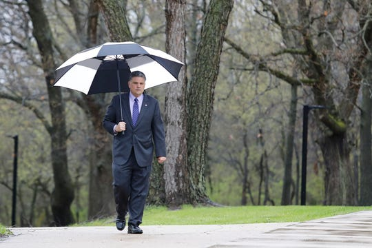 Rockford University President Eric Fulcomer walks back to his office on campus Wednesday, April 29, 2020, after recording remarks for the college's virtual graduation ceremony that will be published May 17.