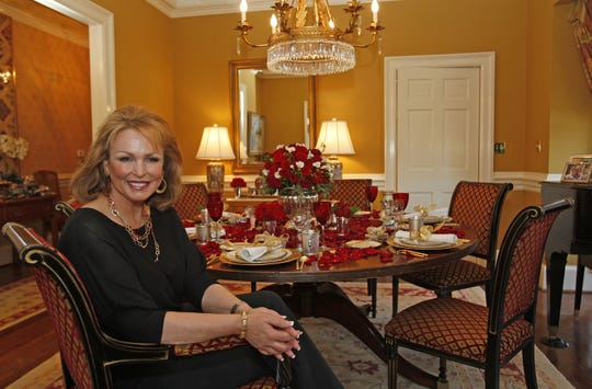Phyllis George sat in the dining room of his town house in Lexington in 2008.