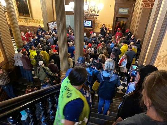 Protesters outside the House chambers at the Michigan Capitol on Thursday, April 30.