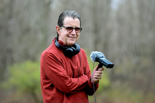 Scott Pohl, a public radio reporter at WKAR, works on a story on his last day of work on Thursday, April 30, 2020, at his home south of Lansing. Pohl has worked at the radio station for 35 years.