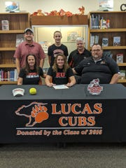 Lucas' Morgan Spitler (front, center) signed her national letter of intent to play softball at Edinboro University surrounded by family and coaches.
