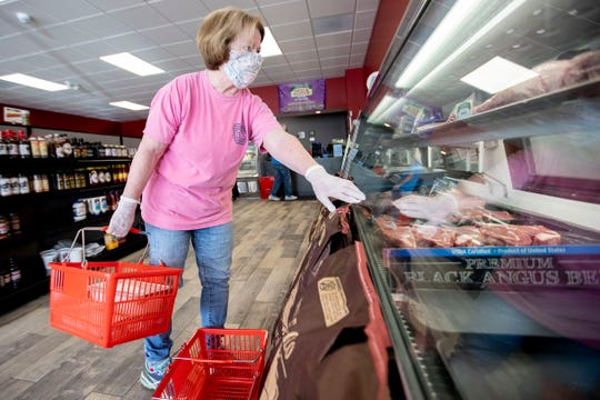 Barbie Hodge, of Collierville, picks out her cut of meat Monday, April 6, 2020, at Thomas Meat and Seafood Market & Catering in Collierville. Hodge says she has felt safer at butcher than traditional grocers as the crowds have been smaller.
