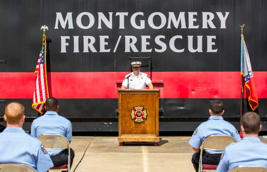 Montgomery Fire Rescue Chief Miford Jordan addresses the departments newest graduates during a short ceremony at the fire station.