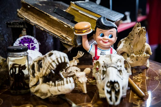 An assortment of animal and human bones, medical antiquities, horror memorabilia, true crime artifacts and other items line the shelves at the entrance of Obscura Tattoo and Oddities in Muncie April 29, 2020. Owner Mitch Campbell sells the collectors items online and at his shop.
