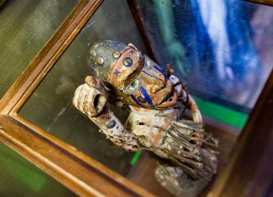 A wooden ritual figure from the Congo displayed at Obscura Tattoo and Oddities April 29, 2020.