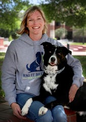 Family Pet Health and Wag It Better Dog Training have joined forces to start the new Walk my Dog program. Heather Moore, with Wag It Better Dog Training, sits with her dog Digger on Thursday, April 30, 2020.