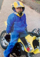Tennessee State running back Jordan Bell sits on his Suzuki dirt bike at 5 years old.