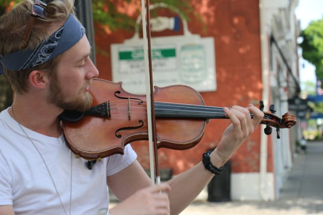 Jerome Eulentrop is often on Main Street on sunny days playing his violin, as seen on April 28, 2020.