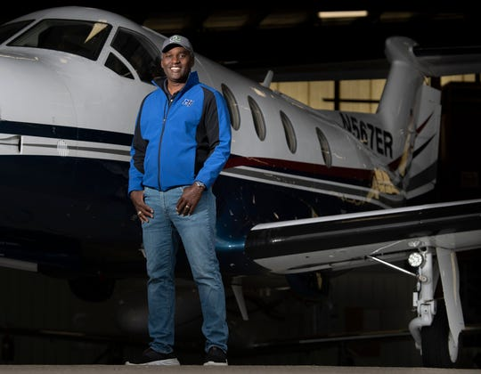 Nashville businessman and entrepreneur Darrell Freeman, who recently volunteered to fly a mission to retrieve COVID-19 test samples to speed up the process for patients, stands with his plane at Hollingshead Aviation Thursday, April 30, 2020 in Smyrna, Tenn.