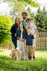 Cindy and James Banker pose for a portrait with their children, Jacob, 12, Clare, 10, and Giles, 6, and their dog Bella at their home in Nashville, Tenn., Thursday, April 30, 2020. During the 2010 flooding, the Bankers were trapped in her neighborhood by high waters, and gave birth to Clare at a neighbor's house.