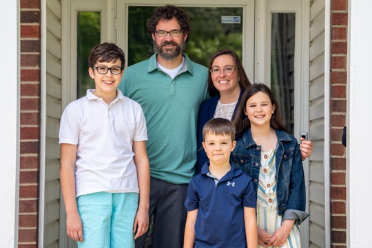 Cindy and James Banker pose for a portrait with their children, Jacob, 12, Clare, 10, and Giles, 6, at their home in Nashville, Tenn., Thursday, April 30, 2020. During the 2010 flooding, the Bankers were trapped in her neighborhood by high waters, and gave birth to Clare at a neighbor's house.