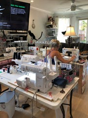 """Janie Favreau sews masks with the help of Cris Ryker and Kitty Sachs, under the moniker"""" Masked Friends of the Food Bank."""""""