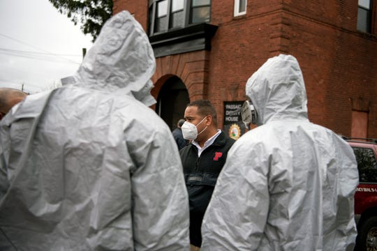Passaic Mayor Hector Lora speaks with Passaic EMTs outside of the Dignity House. Lora organized free coronavirus testing and showers for the city homeless on April 30, 2020 at the Dignity House. Dr. Gammal Hassanien administered the tests.