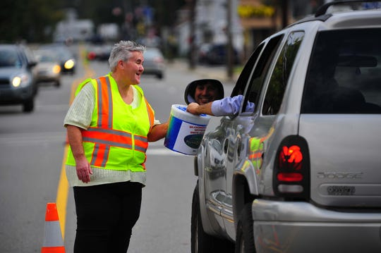 Cyndy Hopper collects money for the Bloomingdale Municipal Drug Alliance in October 2011.