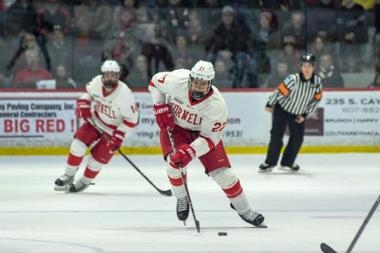Cornell's Morgan Barron, center, makes his way down the ice during their game against Colgate at Cornell University in Ithaca, NY, Saturday, Jan. 26, 2019.