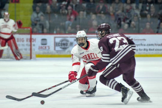 Cornell's Morgan Barron, left, skates up against Colgate's Jeff Stewart during their game at Cornell University in Ithaca, NY, Saturday, Jan. 26, 2019.