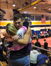 Michael Filieri hugs his mom, Fran Filieri, at a wrestling match.