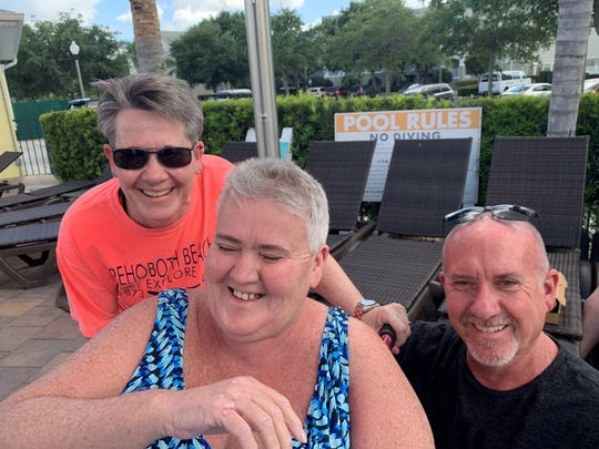 Cyndy Hopper (middle) is seen in May 2019 with her sister Sue Winning and brother Scott Winning.