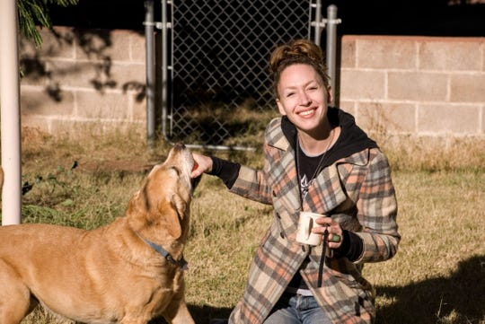 Shauna Smith, pictured with her dog at a family member's home in Arizona.