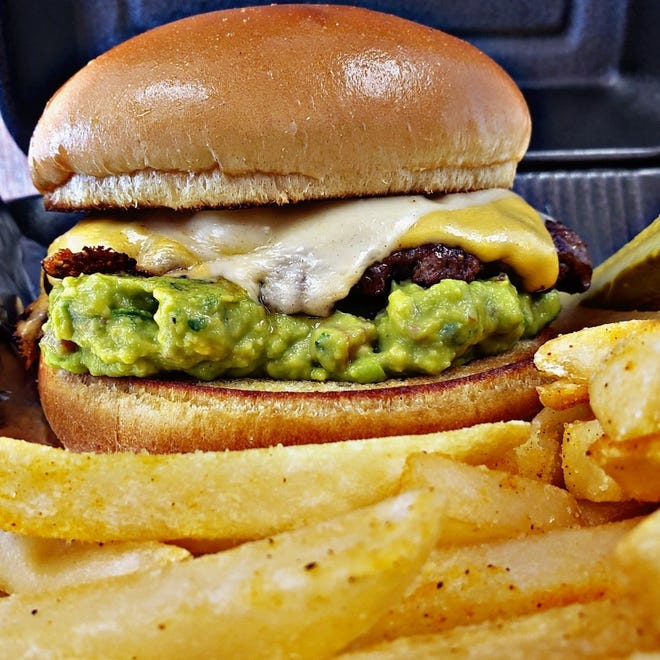 Double cheddar guacamole burger with fries from Urban Cafe, 1100 S. Main St. Urban Cafe has daily deals everyday.