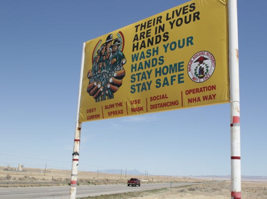 The Navajo Housing Authority placed a sign south of Shiprock on U.S. Highway 491 to remind the public to follow health guidelines for combating the coronavirus.