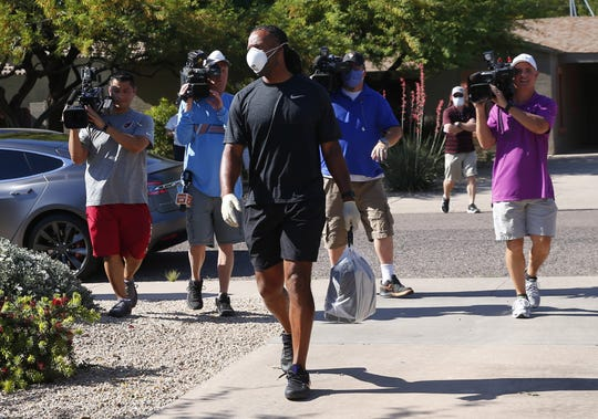 Arizona Cardinals wide receiver Larry Fitzgerald drops off food from Ocean 44 Restaurant to various health care workers helping with COVID-19.