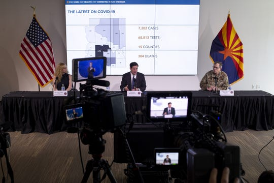 Gov. Doug Ducey speaks during a press conference about extending his statewide stay-at-home order on April 29, 2020, at the Arizona Commerce Authority Conference Center in Phoenix.