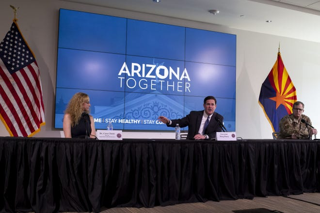 Governor Doug Ducey speaks during a press conference about extending his statewide stay-at-home order on April 29, 2020, at the Arizona Commerce Authority Conference Center in Phoenix.