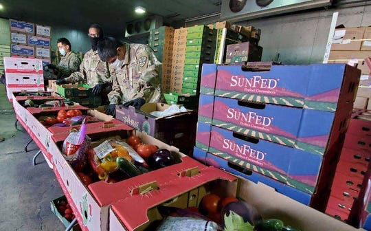 Arizona National Guard members are deployed to help the food bank in Nogales,  helping sort produce and box it up so it can handed out to families in need.