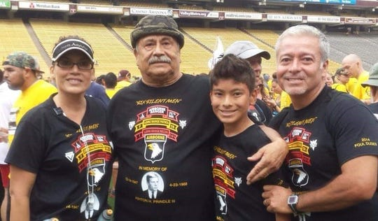 Tony Tercero (second from left) with his daughter Cyndi and grandson Ryan at a Pat's Run several years ago. On the right is Cyndi's husband, David Sandoval.