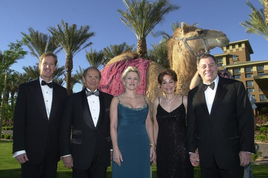 From left, Michael White, Mort Fleisher, Penny Nissley, Karen Baum, and Herb Baum stand with a camel that was donated by the Dial Corp. for use in a charity dinner and auction to raise money to fight diabetes on March 30, 2003.