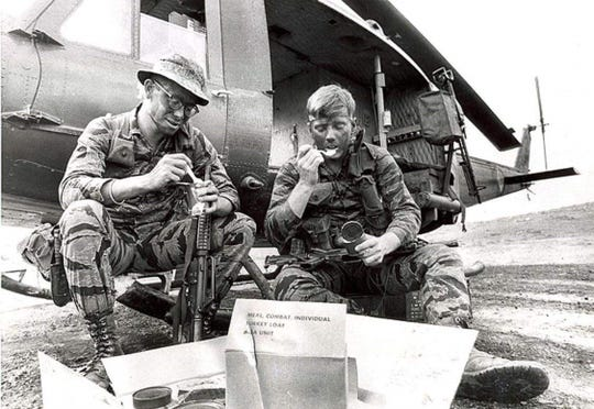 Tony Tercero (left) having a turkey loaf Thanksgiving Day meal in Vietnam with fellow soldier Paul Coleman.