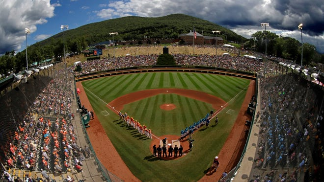 In this Sunday, Aug. 25, 2019, file photo, River Ridge, Louisiana, lines the third baseline and Curacao lines the first baseline during team introductions before the Little League World Series Championship game at Lamade Stadium in South Williamsport, Pa.