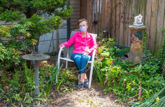 Julie Swope finds solace sitting in her backyard garden as she waits for a lung to become available.