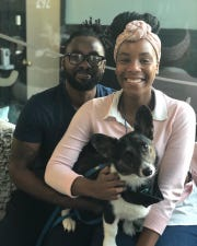 Steven Hall (left) and Jasmine Vaughn-Hall (right) pose with their corgi, Chichi, who was freshly groomed, but didn't stay clean for long because of her love for fresh cut grass and dirt.