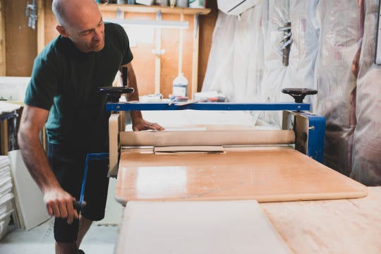 Cory Burrows rolls out a slab of porcelain for MB Art Studios.