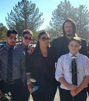 Ian McElhaney, second from left, stands with his siblings Aaron, far left, sister Nikki Holliday, brother Charles Koons and younger brother (far right) Aden McElhaney after their mother's funeral earlier this year.