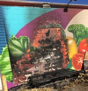 Damage from the burned mattress along the mural on the Security Public Storage buildings. April 30, 2020.